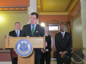 Gov. Dannel P. Malloy with his two most recent nominees to the Appellate Court, Elliot Prescott and Raheem Mullins. The latter was Malloy's youngest appointee.