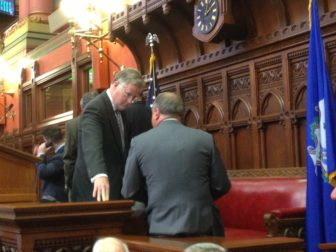 House Speaker J. Brendan Sharkey talking to House GOP Leader Lawrence F. Cafero Jr. before Cafero addressed the House.