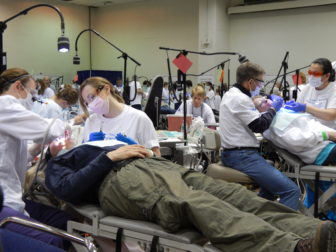 This is a photo of people receiving dental care at the CT Mission of Mercy free dental clinic.