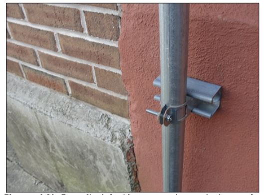 This is a photo of a protruding, uncovered bolt in an outdoor play area at a Connecticut day care center.