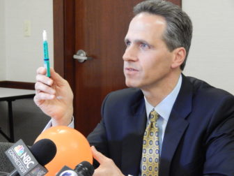 This is a photo of Griffin Hospital CEO Patrick Charmel holding up the type of insulin pen that was misused, potentially exposing patients to disease transmission.