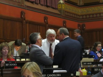Rep. Craig Miner, center, the central player in the fish for fracking deal.