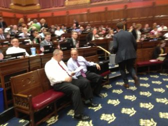 House Majority Leader Joseph Aresimowicz huddles Thursday with his GOP counterpart, Lawrence F. Cafero.