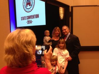 Mark Greenberg posing with his family as the votes were counted.