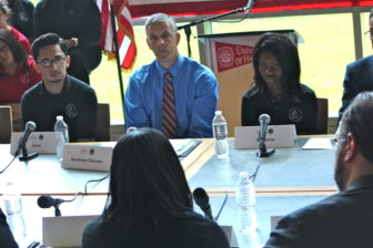 U.S. Education Secretary Arne Duncan listens to students at a Hartford magnet school.