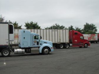 Trucks parked at the state rest stop on I-84 in Willington. (file photo)