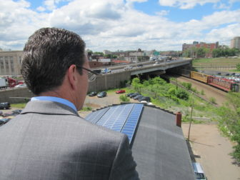 Gov. Dannel P. Malloy inspecting rooftop solar panels.