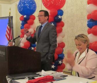 AFL-CIO leader Lori Pelletier applauds Gov. Dannel P. Malloy.
