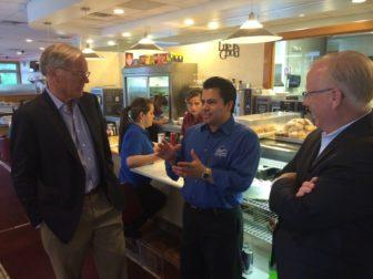 Tom Foley listens to Elmer Palma. At right, Mayor Mark Boughton.