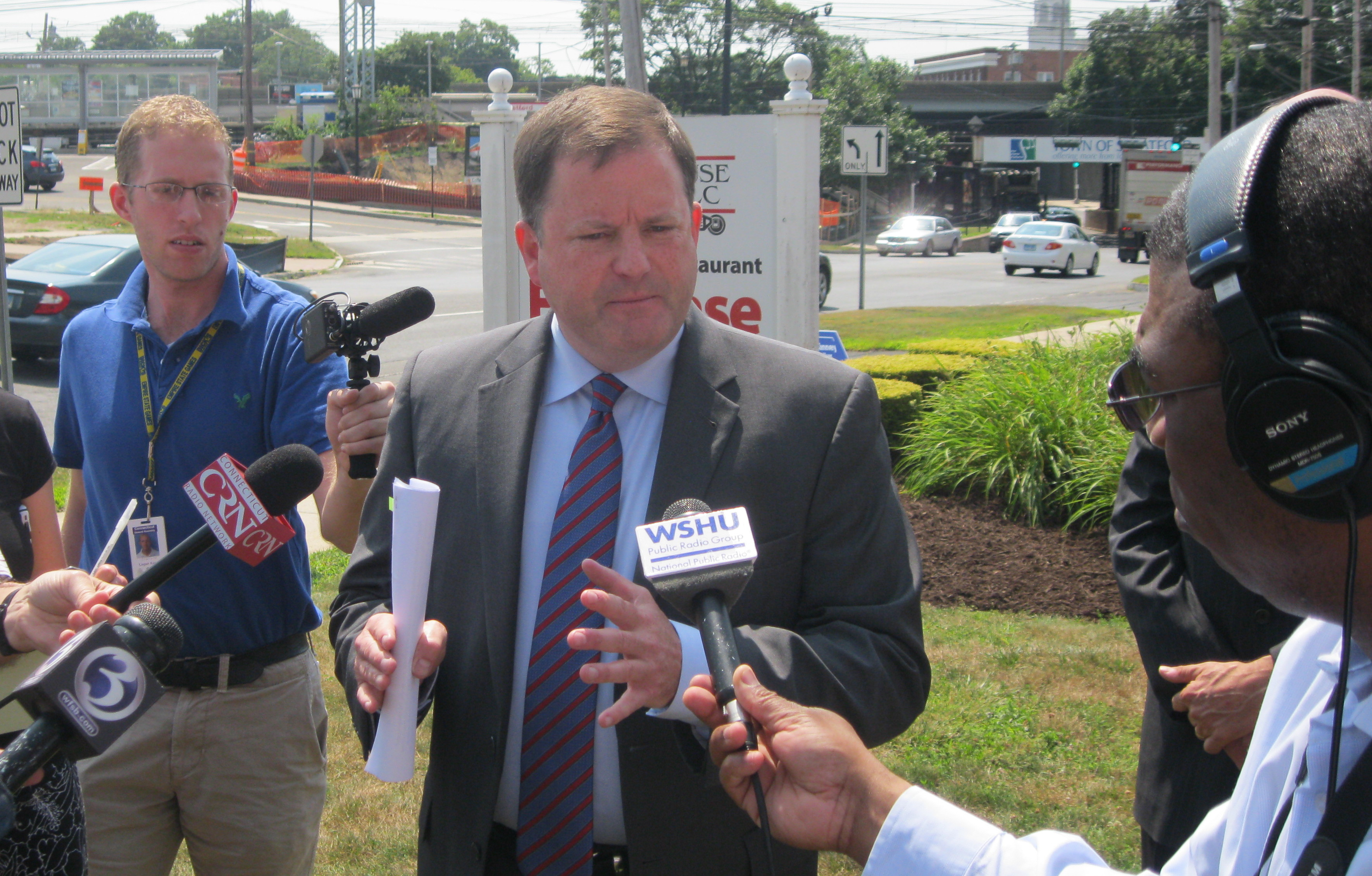 GOP gubernatorial candidate John McKinney discusses his tax cut plan outside of a Stratford shopping center