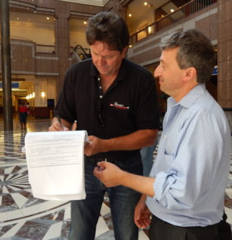 Joe Visconti signs Jonathan Pelto's petition for a spot on the November ballot for governor. Pelto later signed Visconti's petition.