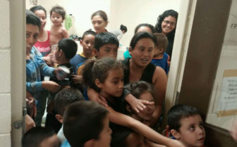 This photo taken by U.S. Rep. Henry Cuellar, D-Texas, is of detained children, and some of their mothers, at a facility in Texas.