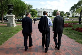 VA chief nominee McDonald walks with President Obama and Vice President Joe Biden.