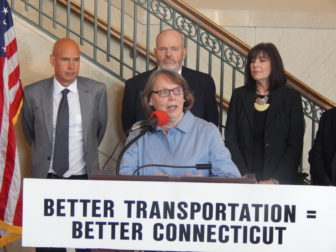 Former Transportation Strategy Board member Karen Burnaska and other advocates challenge gubernatorial candidates to focus on state's transportation needs.