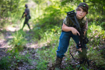 Dalton Davis, 10, participates in a patrol drill in the woods of Batesville, Miss., with the Citizens Militia of Mississippi.