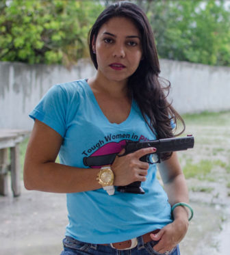 "A former Olympian from Venezuela, Gabby Franco was one of the first women to compete on History's ""Top Shot"" reality show. Picking a favorite gun is like trying to pick a favorite shoe, she said. (Photo by Natalie Krebs/News21)"