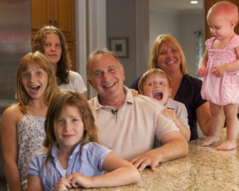 Greenberg's campaign website offers potential supporters this photo of him, his wife, Linda, and their five children.