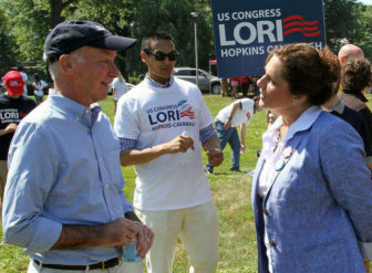 Lori Hopkins-Cavanagh engages Rep. Joe Courtney in conversation at a public event.