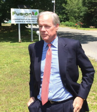 Tom Foley outside Fusion Paperboard.