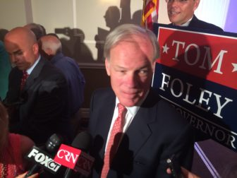 Tom Foley swarmed by reporters after accepting the GOP nomination.