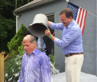 John P. McKinney douses  Foley after the day after the GOP primary as part of the ALS ice bucket challenge.