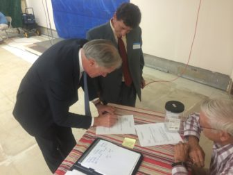 Tom Foley signs a form accepting the endorsement of the IndependentParty.