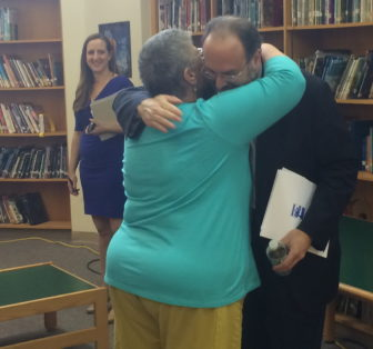 Melodie Peters and Stefan Pryor embrace. Peters advocated his removal.