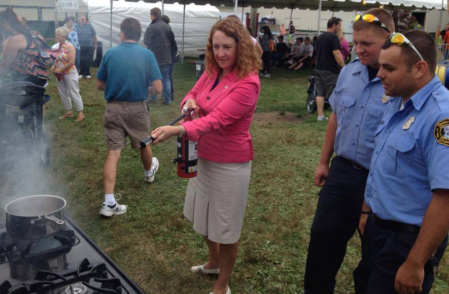 Rep. Elizabeth Esty gets a hands-on lesson from fire fighters at the Terryville Fair.