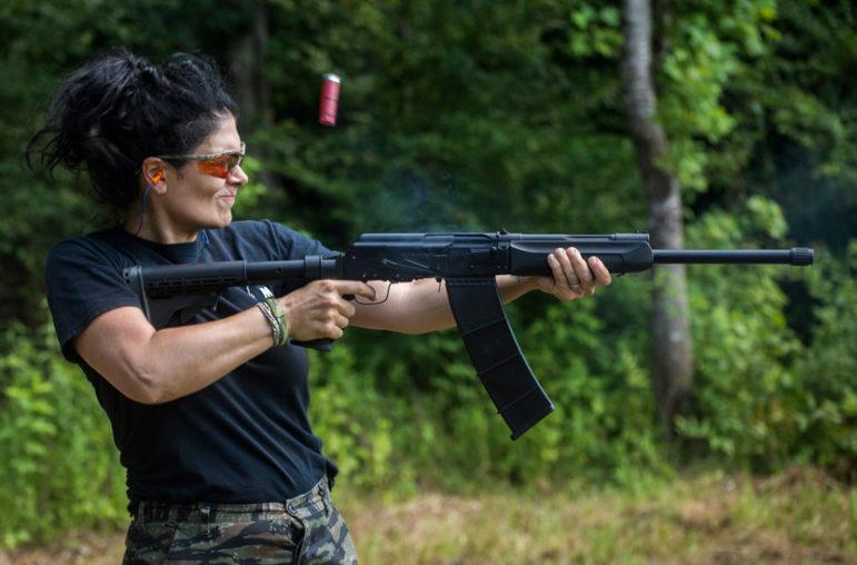 Kimberly Jones, a member of the Citizens Militia of Mississippi  fires a semi-automatic tactical shotgun.