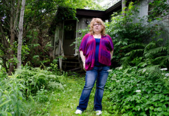 Sarah Engle stands outside the home where she and her mother were shot by Engle's ex-boyfriend, James Lahoud, in 2008. Engle's mother, Charlotte Engle, was killed.