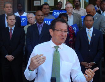 Gov. Dannel P. Malloy unveils his proposal for urban small business tax incentives outside Faith Congregational Church in Hartford during the 2014 campaign.