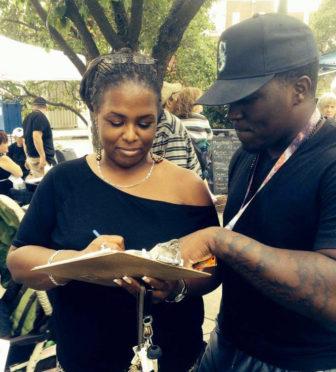 An Esty volunteer registers new voters in Danbury at the Caribbean Jerk Fest on Sept. 20.
