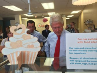 Gov. Malloy watches President Clinton examine the vegan offerings at Katalina's bakery.