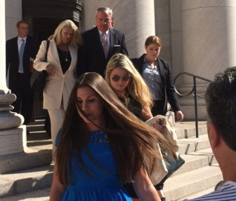 John G. Rowland exits court with his wife, Patricia, preceded by his daughters.