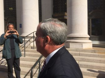 John G. Rowland outside U.S. District Court in New Haven.