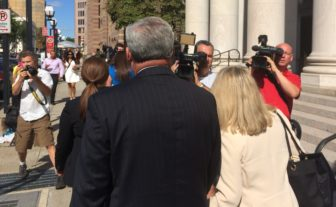 Rowland his wife, Patty, face the cameras at day's end.