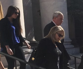 John G. Rowland departs with his wife, Patty, and a daughter after guilty verdict.
