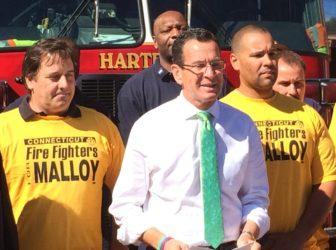 Gov. Dannel P. Malloy celebrated an endorsement by the Uniformed Professional Fire Fighters Association, then attacked Tom Foley.