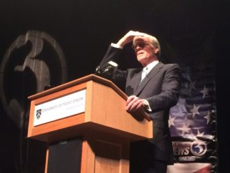 Tom Foley looks into the lights during the sound check at a debate Tuesday.