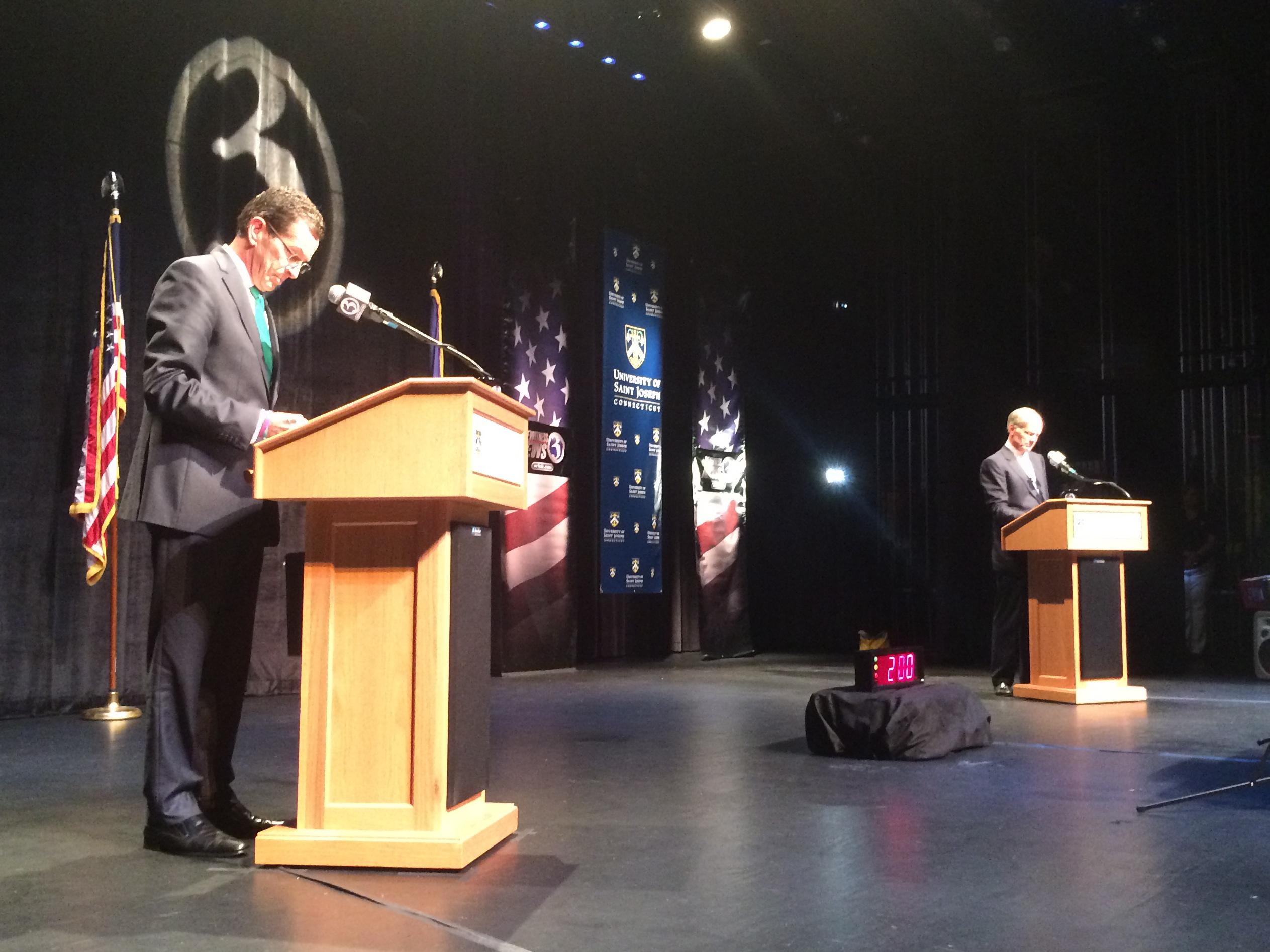 Gov. Dannel P. Malloy checks his notes before the broadcast.