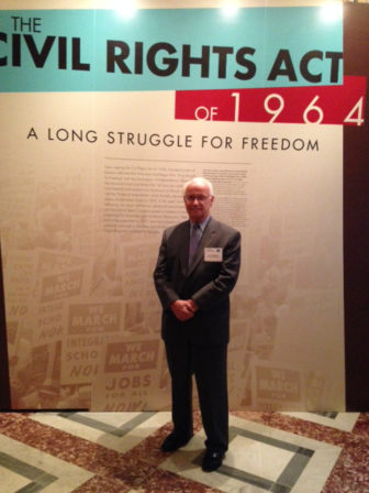 Robert Forrester, CEO of Newman's Own, stands at the civil rights exhibit at the Library of Congress.