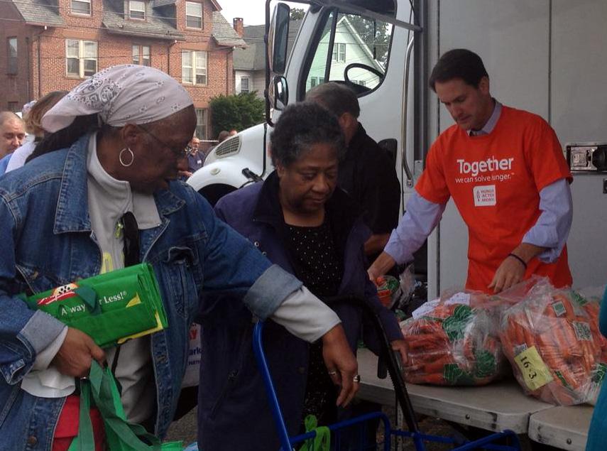 Rep. Jim Himes, D-5th District, distributing food in a Bridgeport neighborhood Sept. 24.