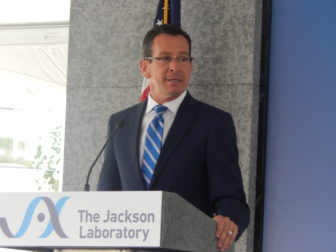 Gov. Dannel P. Malloy addresses the crowd moments before the official opening of the new genomic medicine research institute in Farmington