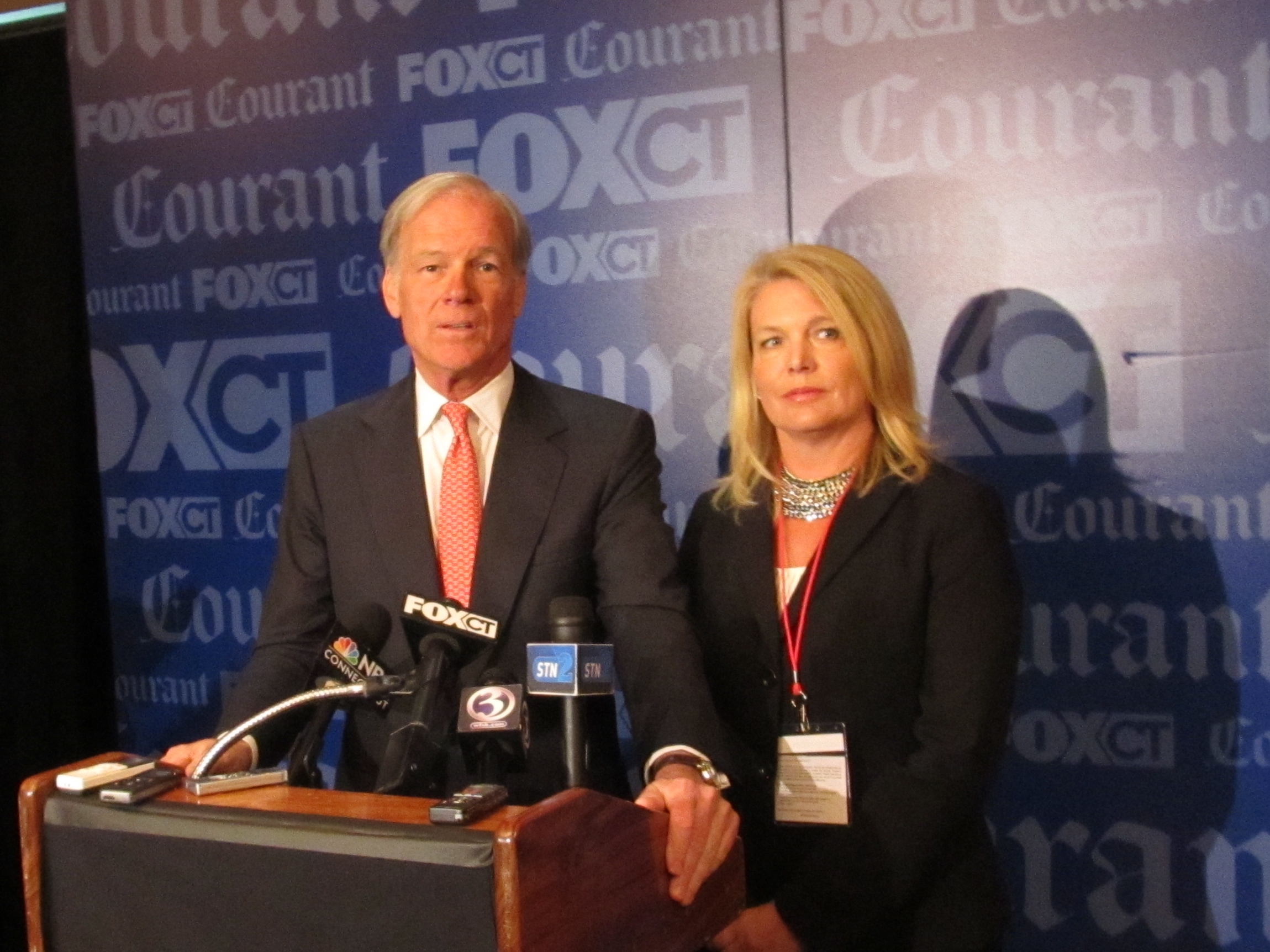 Tom Foley talked to reporters, accompanied by his running mate, Heather Bond Somers.