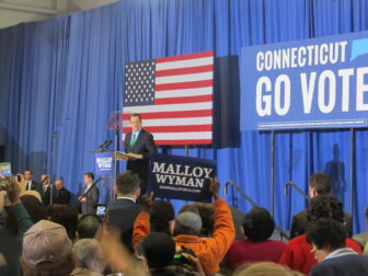 Malloy at a rally headlined by Michelle Oama.