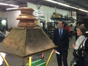 Gov. Dannel P. Malloy touring Penn Globe, a lighting company that added three jobs.