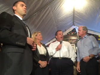 Chris Christie, flanked by Heather Bond Somers, Tom Foley and an aide.