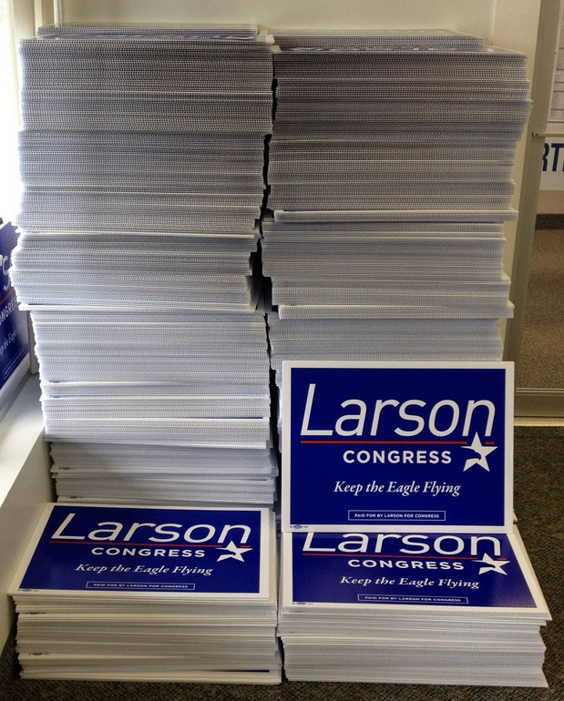 This huge stack of lawn signs is n indication of Larson's enormous political war chest and campaigning power.