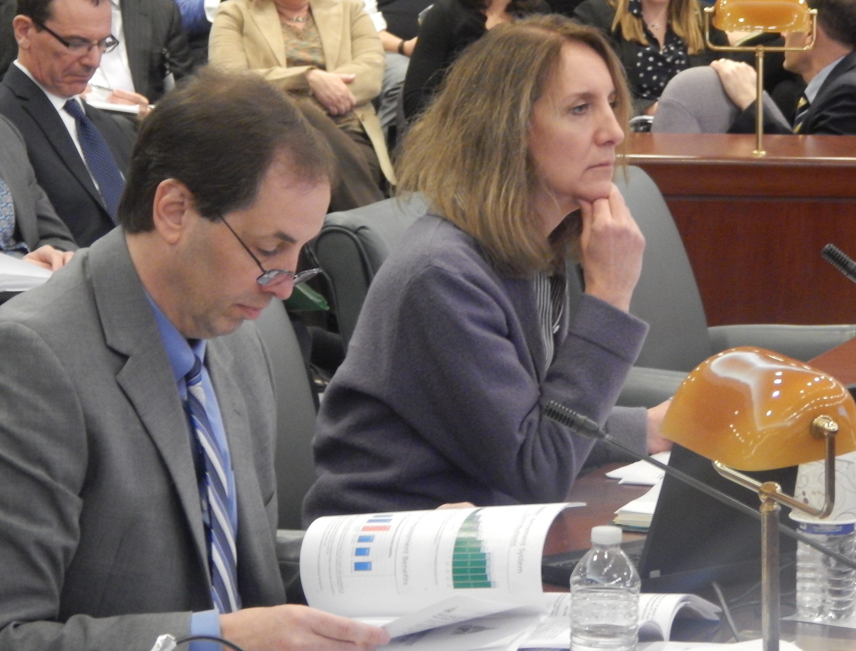 Alan Calandro, executive director of the Office of Fiscal Analysis, and Karen Buffkin, deputy budget director for the Malloy administration, answer legislators' questions Friday.