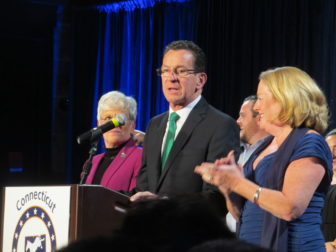 Malloy declaring victory. His wife, Cathy, applauds.
